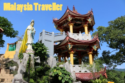 Pagoda, Guan Yin  statue and koi fish pond.
