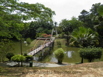 Bridge and lake at Labuan Botanical Garden