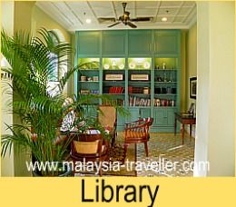The cosy library at The Majestic Malacca