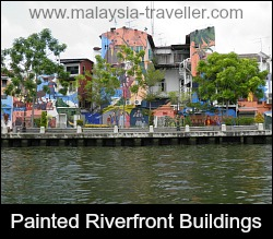 Painted murals along the river bank.