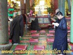 Buddhist Monks Praying at Kek Lok Si Temple